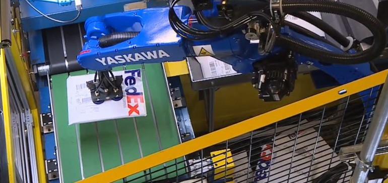 A Yaskawa robot sortation arm picking up a parcel that benefits the overall efficiency of the supply chain