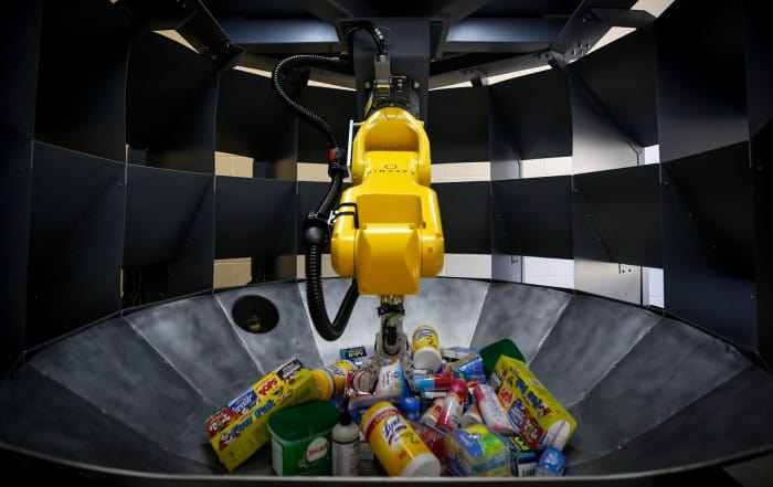Kindred AI robotic arm sorting objects from a bin, improving supply chain productivity