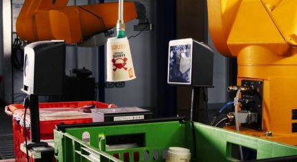 Ocado Grocery Picking robot lifting a grocery item, benefiting the overall supply chain